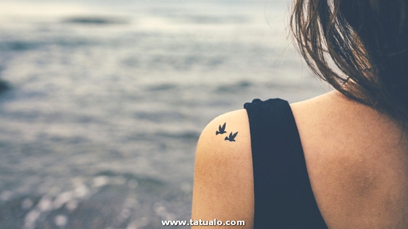 Girl With Birds Tattooed On Shoulder. Freedom Concept